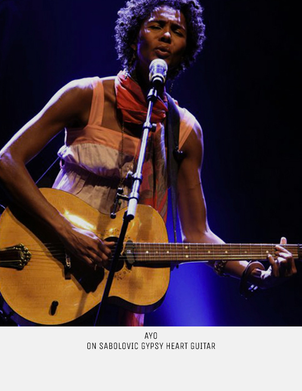 Great singer Ayo on Sabolovic Gypsy Heart acoustic archtop guitar with calligraphy